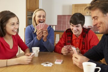 Family playing euchre card game