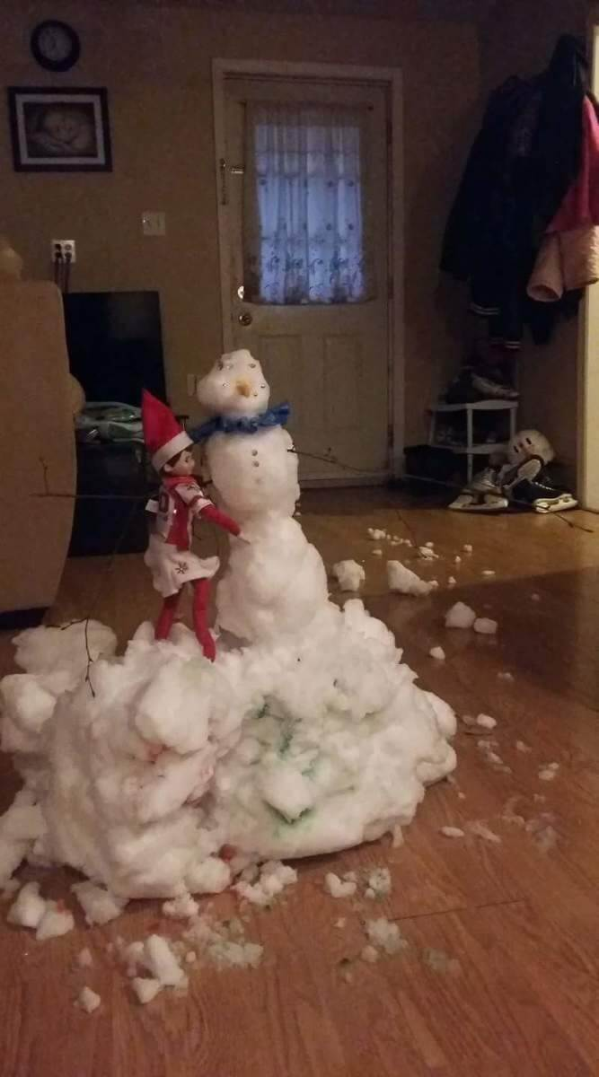 elf on the shelf and a real snowman