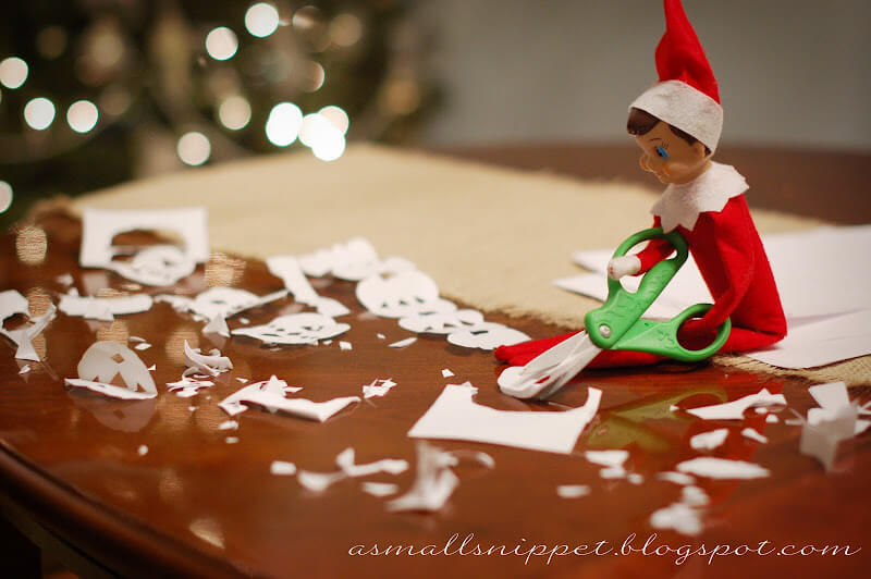 elf on the shelf and paper snowflakes