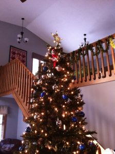 Elf on the shelf stuck in the christmas tree